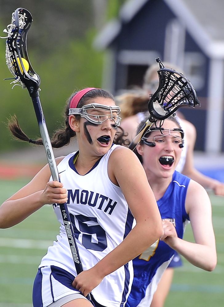 Grace O'Donnell, who combined with Shannon Fallon to score 10 goals with three assists for Yarmouth, heads to the goal to score as Caroline McKeon defends for Falmouth. Yarmouth improved its record to 8-1 and dropped the Yachtsmen to 3-6.