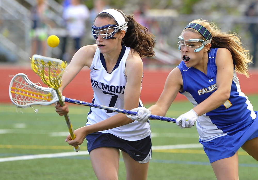 Ellie Fitzgerald of Falmouth, right, knocks the ball away from Lauren Bartlett of Yarmouth during Yarmouth's 17-9 victory Wednesday in a schoolgirl lacrosse game at Yarmouth High. Photos by Gordon Chibroski/Staff Photographer