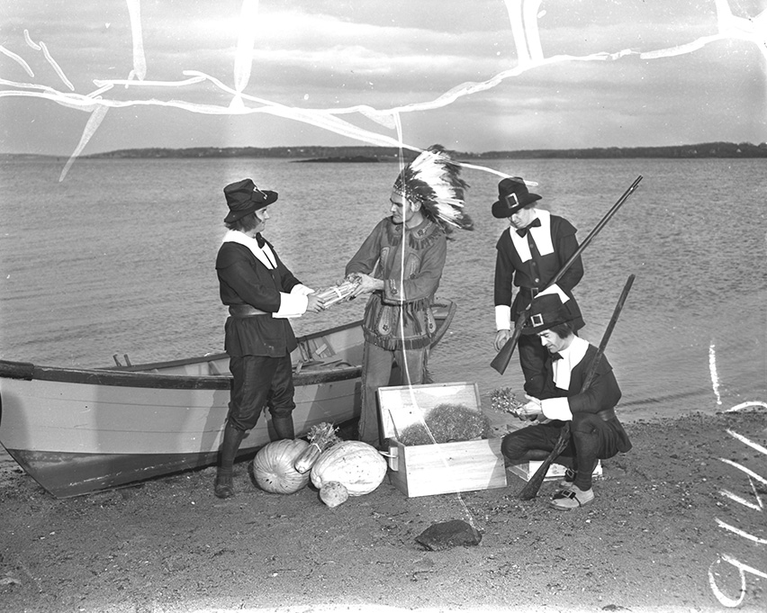 Costumed Jaycees reenact the landing of the Pilgrims on the Maine coast in search of food to take back to the Plymouth colony. Left to right are Bruce C. McGorrill, James E. Demetriou, portraying Squanto; Richard E. Oransky, and O. William Robertson.