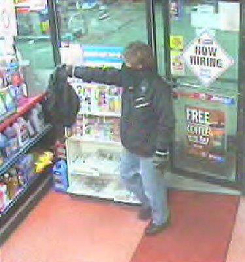 This photo taken from surveillance video shows one of the robbery suspects entering the Xtramart at 28 Elm St., Saco, Wednesday night. Provided by the Saco Police Department