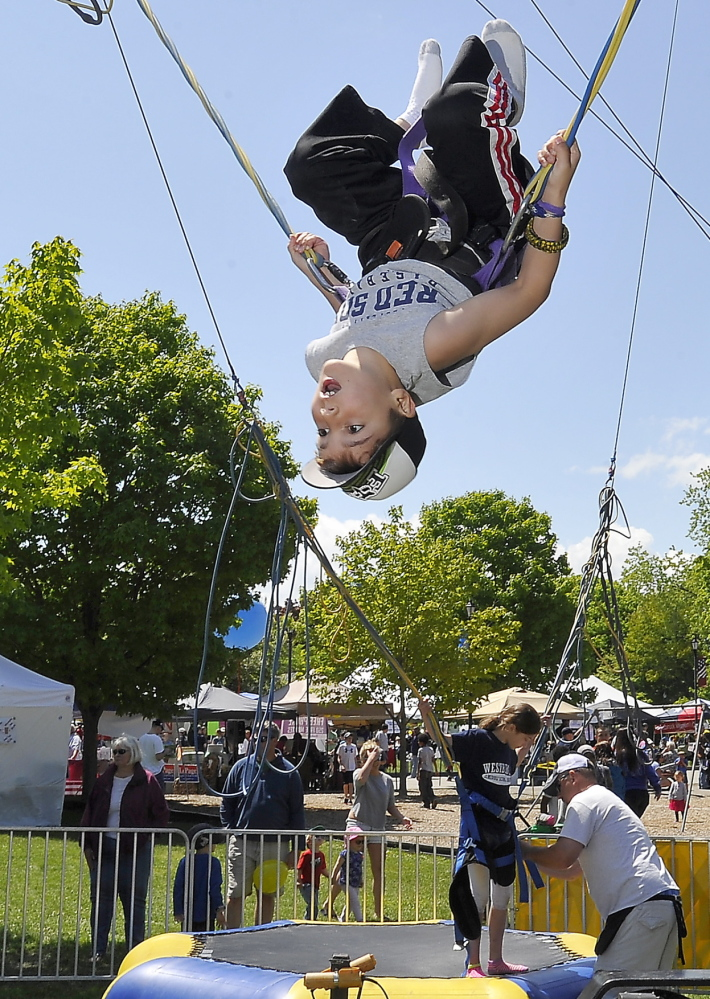 Ethan Gautreau, 8, of Westbrook, enjoys doing back flips on a trampoline at the Westbrook Together Days festival which celebrated the 200th anniversary of the city. Photos by Gordon Chibroski/Staff Photographer