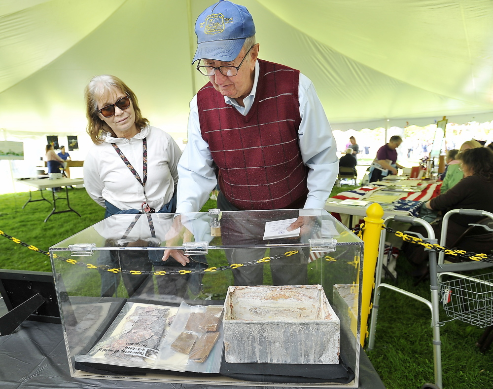 Bill Oâ€'Gara explains some of the components of the stone time capsule to Nancy Gaudet of Westbrook. The contents will be revealed during the Westbrook Bicentennial Celebration at the Westbrook Performing Arts Center on June 9.