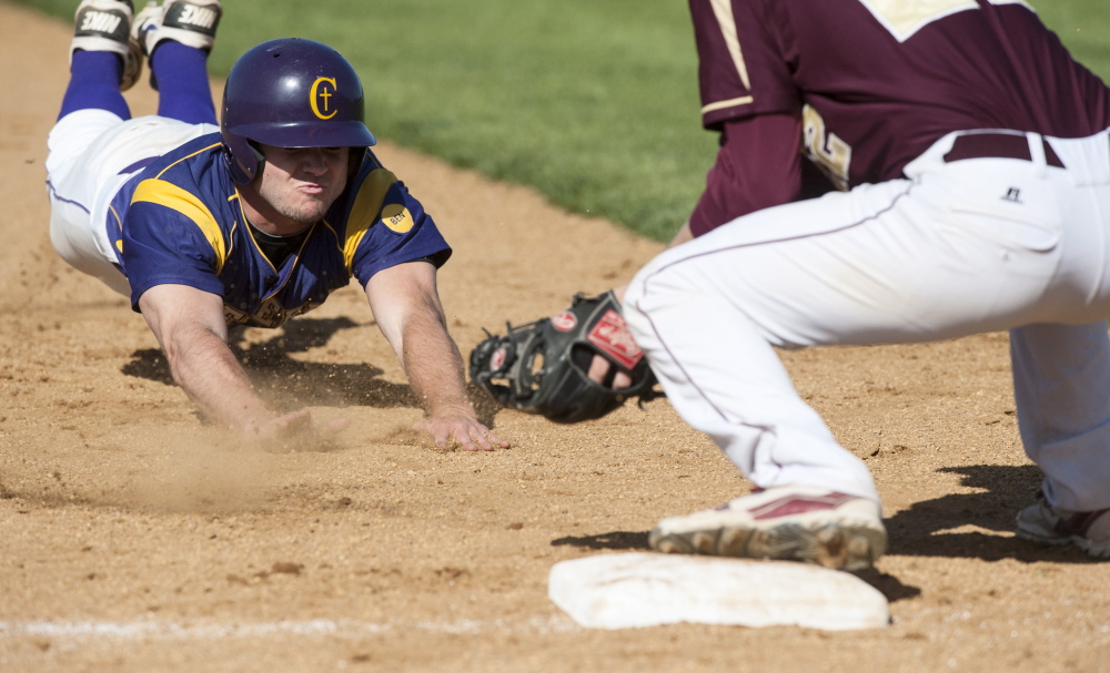 Brad Carney of Cheverus slides into third base but finds the ball waiting for him Thursday as Alex Fallon of Thornton Academy applies the tag during the second inning of Thornton's 4-3 victory. Logan Werlinger/Staff Photographer