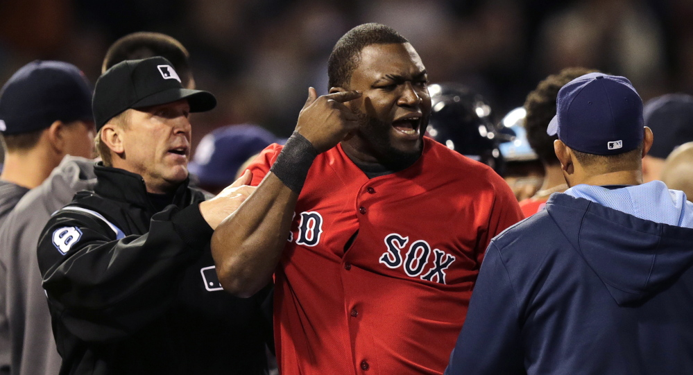 Boston Red Sox designated hitter David Ortiz is held back by umpire Jeff Kellogg after benches cleared after Tampa Bay Rays starting pitcher David Price hit Mike Carp with a pitch during the fourth inning of a baseball game at Fenway Park in Boston, Friday, May 30, 2014. The Associated Press/Charles Krupa