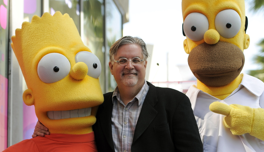 "Matt Groening, creator of ""The Simpsons,"" poses with his characters Bart Simpson, left, and Homer Simpson. The Associated Press"