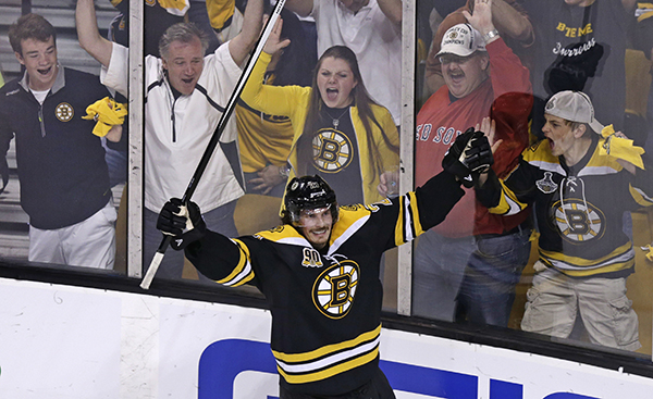 Boston Bruins left wing Loui Eriksson (21) celebrates his goal against Montreal Canadiens goalie Carey Price during the third period of Game 5 in the second-round of the Stanley Cup hockey playoff series in Boston, Saturday.