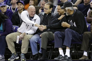 Steve Ballmer, left, shakes hands with former NBA players Bill Russell, right, and