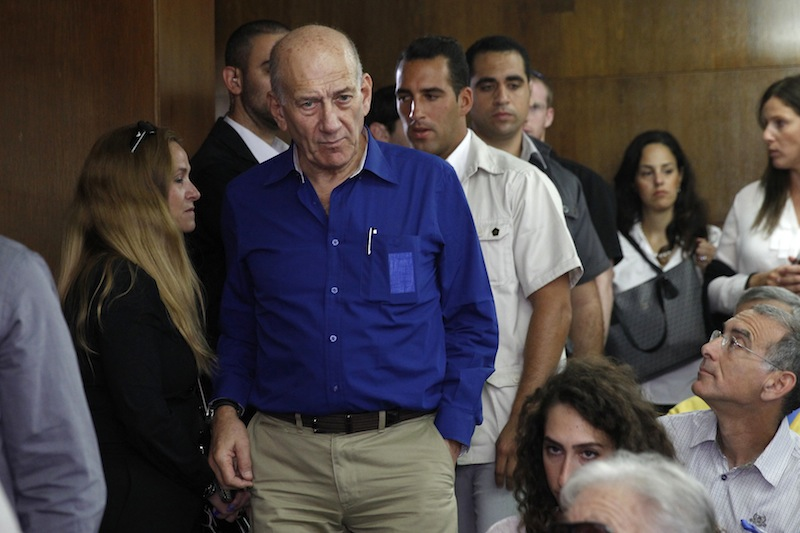 Israel's former Prime Minister Ehud Olmert appears at the Tel Aviv District Court in Israel on Tuesday. He was sentenced to six years in prison for his role in wide-ranging bribery case, capping a stunning fall from grace for one of the most powerful men in the country.