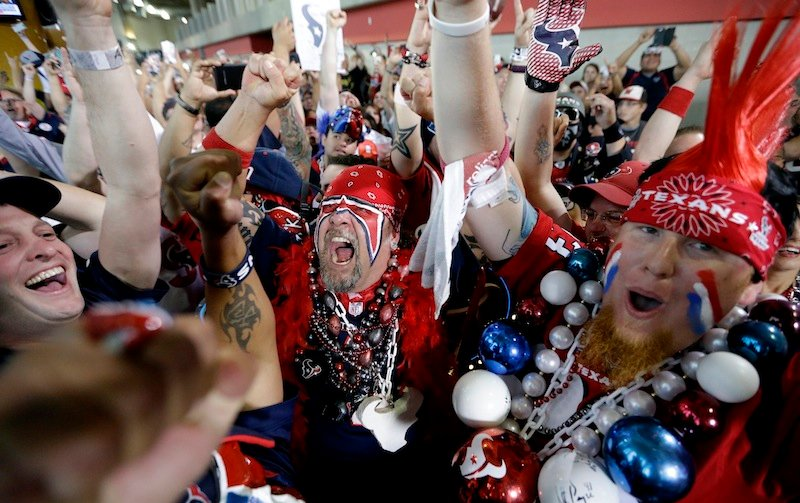Houston Texans fans celebrate after the Houston Texans chose South Carolina defensive end Jadeveon Clowney as the No. 1 overall pick.
