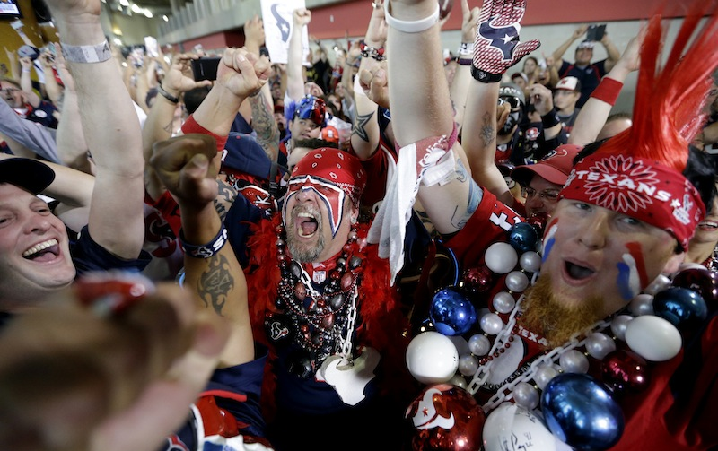 Houston Texans fans celebrate after the Houston Texans chose South Carolina defensive end Jadeveon Clowney as the number one overall pick.