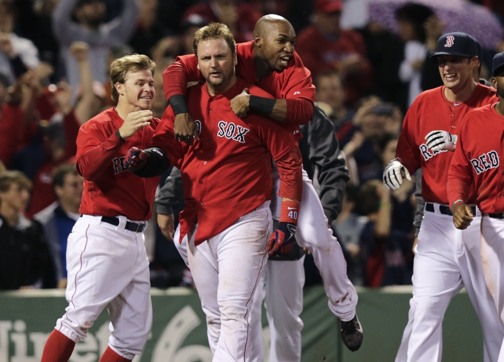 Red Sox teammates congratulate A.J. Pierzynski after his game-winning RBI triple in the bottom of the 10th inning off Tampa Bay Rays relief pitcher Juan Carlos Oviedo at Fenway Park on Friday. The Red Sox defeated the Rays 3-2.