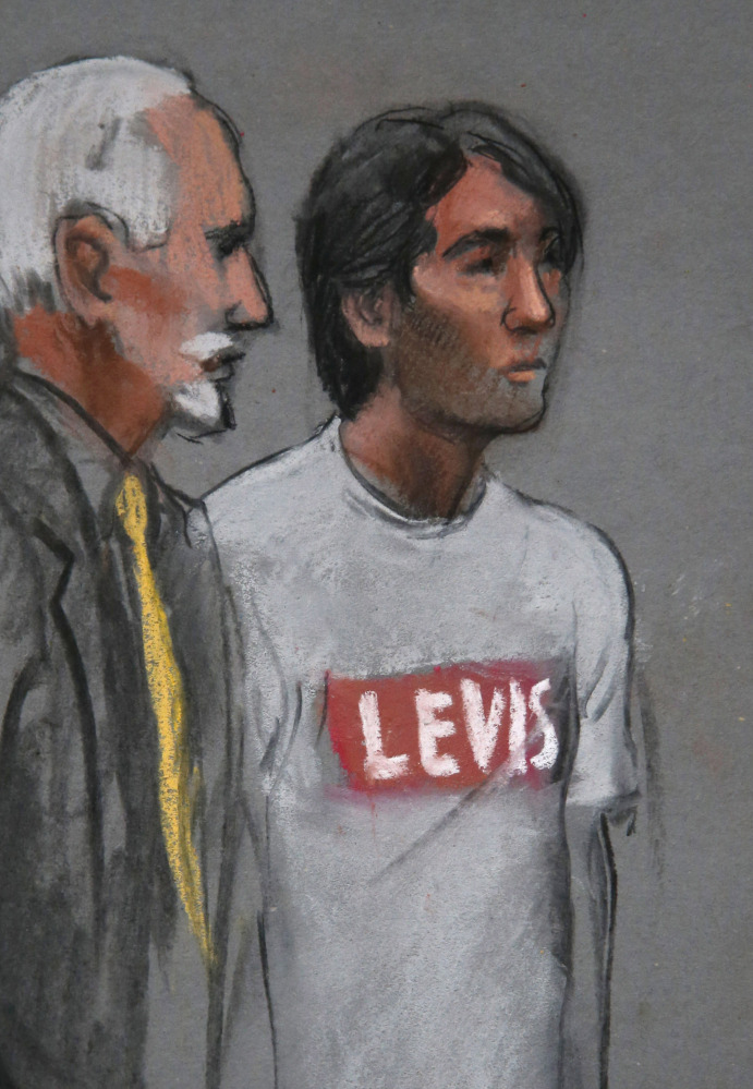 The Associated Press In this sketch, Khairullozhon Matanov, right, with attorney Paul Glickman, appears in federal court Friday in Boston. He is being held until a hearing Wednesday.