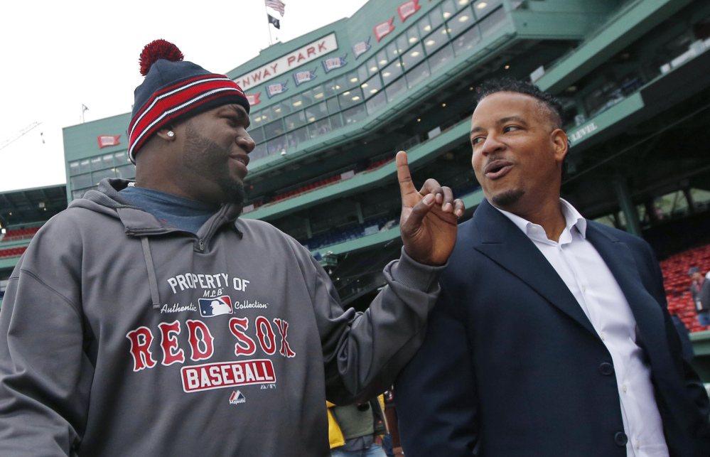 They were the bedrock of the batting order in 2004, the year the Boston Red Sox tore apart that 86-year millstone and captured the World Series. And Wednesday they were together again in Fenway Park – David Ortiz, left, and Manny Ramirez. The Associated Press
