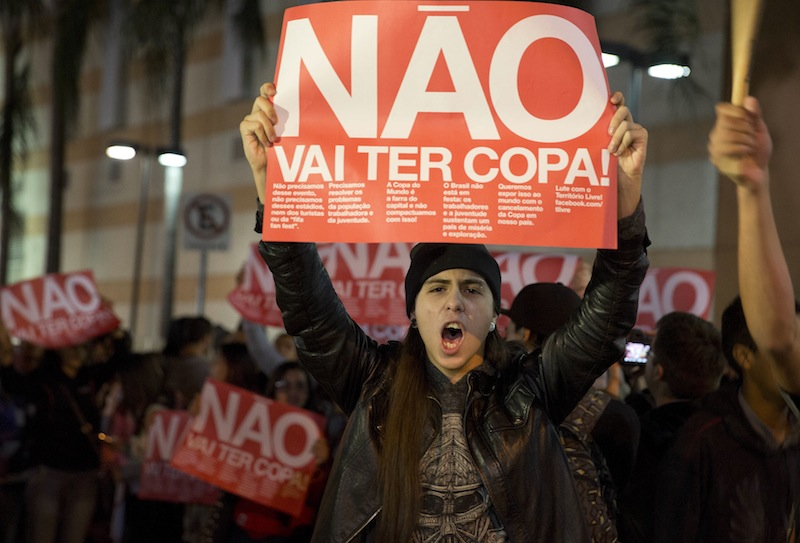 """A demonstrator holding a banner that reads in Portuguese """"There won't be a Cup"""" protests against money spent on the World Cup preparations in Sao Paulo on April 29."""