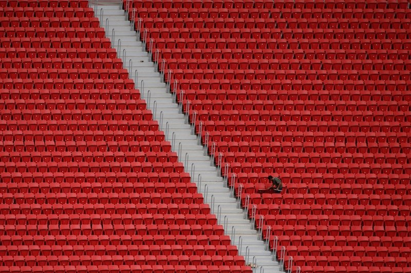 A worker is seen April 8 at the the Mane Garrincha stadium, in Brasilia.
