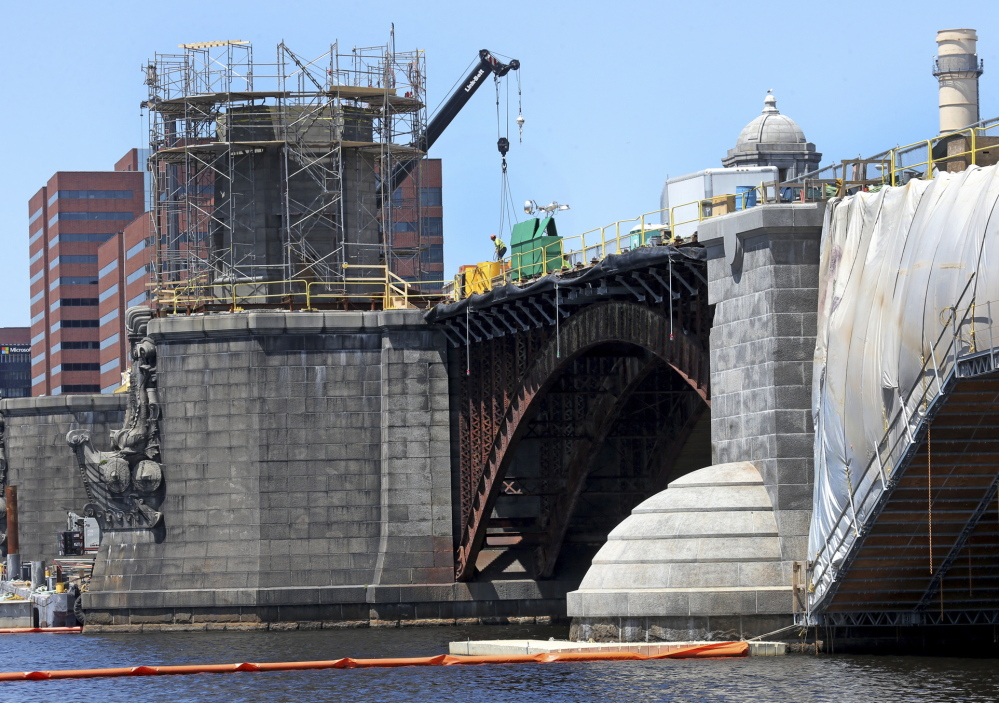 Contractors working to overhaul the Longfellow Bridge linking Boston to Cambridge, Mass., are getting an education in period engineering and scouring the region for appropriate materials. David L. Ryan/Boston Globe
