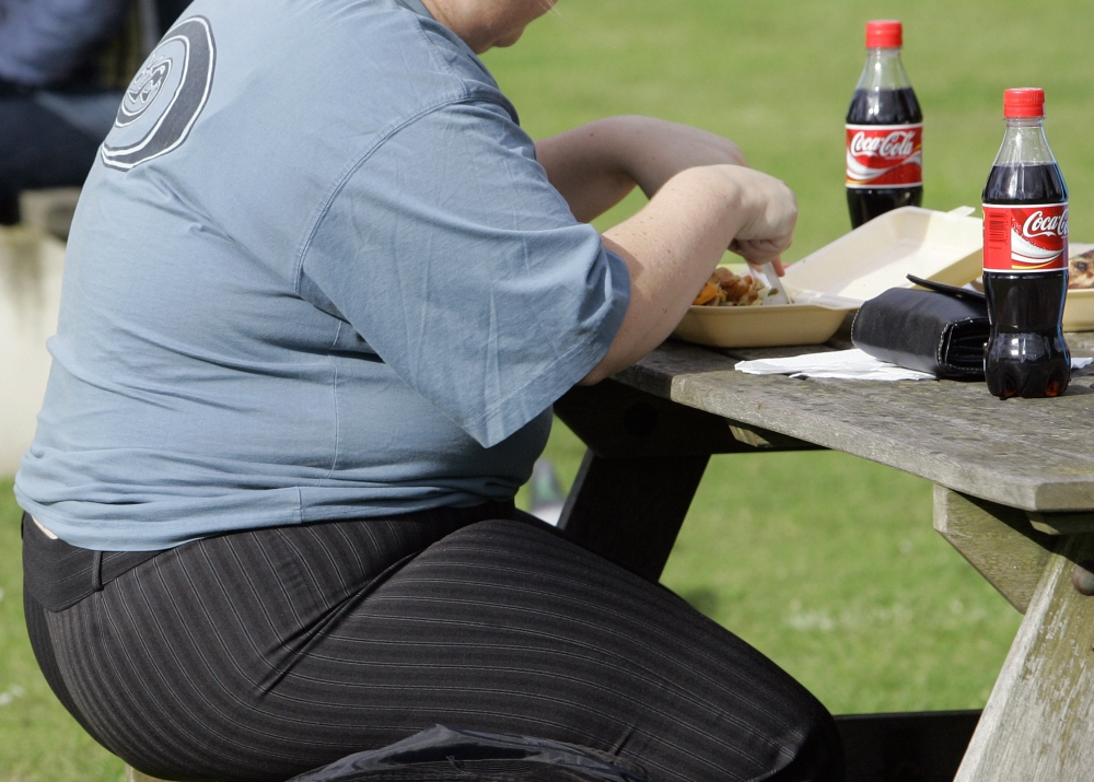 A heavy person eats a meal in London. About two in three adults in the U.K. are overweight, making it the fattest country in Western Europe. The Associated Press