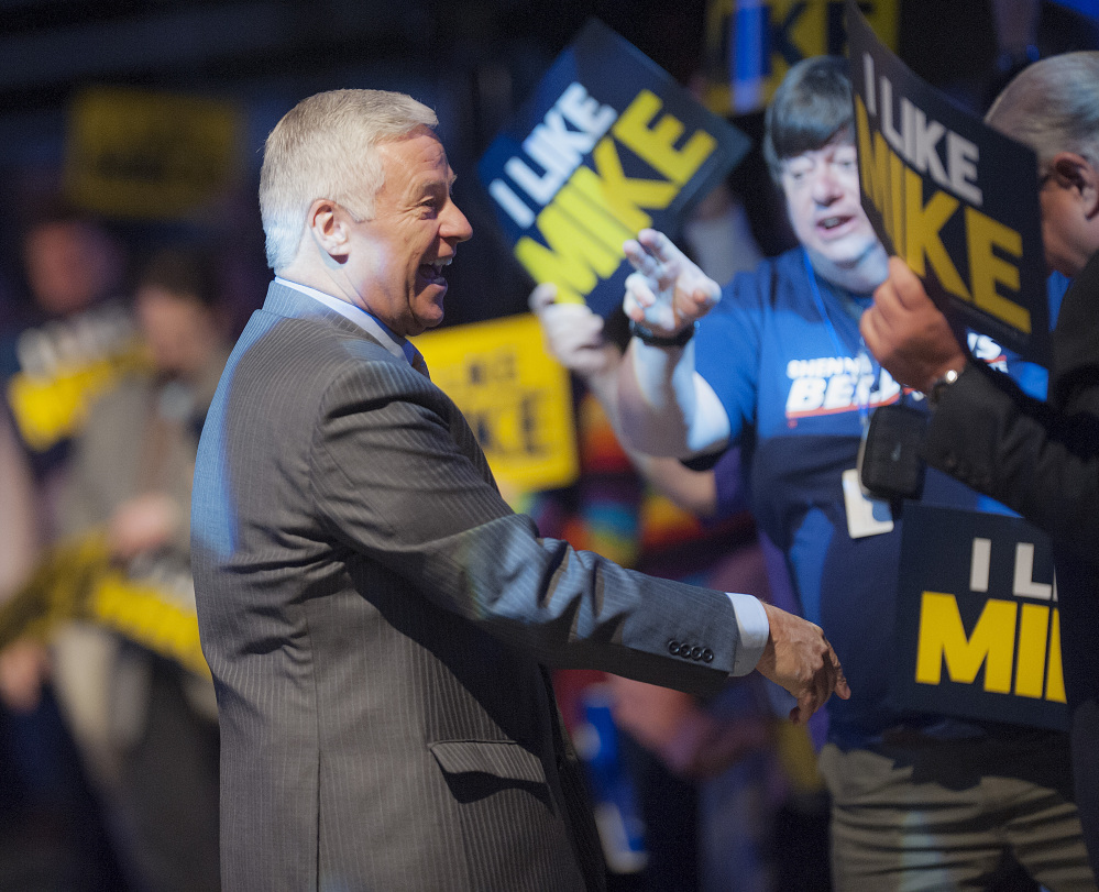 U.S. Congressman Mike Michaud, a candidate for governor in Maine, is welcomed to  speak at the Maine Democratic Convention in Bangor, Maine, Saturday,  May 31, 2014. (AP Photo/Michael C. York)
