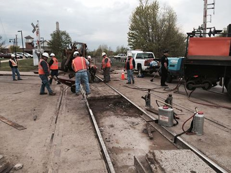 Pan Am Railways maintenance crews had more difficulty than expected removing a rail Thursday at the crossing with Main Street, causing delays.