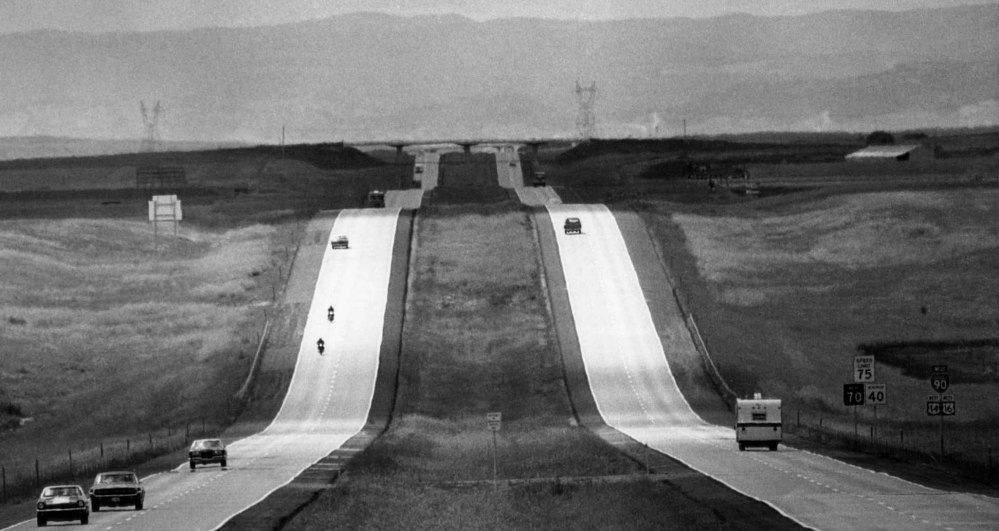 Cars travel on Interstate 90, into the Black Hills in Murdo, S.D., in 1972. Some Americans are trying transportation alternatives and rethinking car ownership. The Associated Press