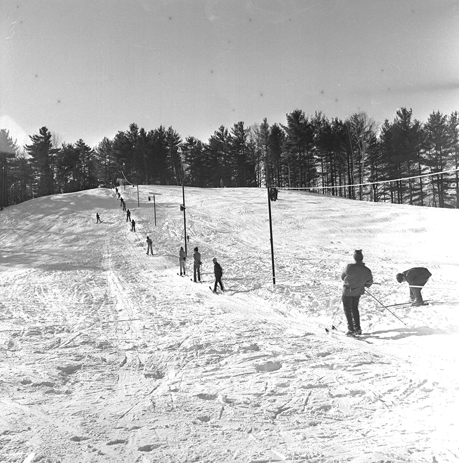 A sunny day in December 1970 at the Gorham Community Ski Tow, located off Water Street in Gorham village. Originally published in the Dec. 31, 1970 Portland Evening Express. Courtesy of Portland Public Library Special Collections & Archives.