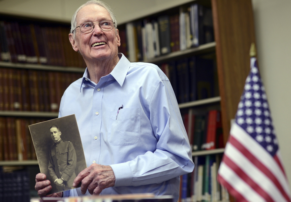 Vincent Radel Keating, of Fairfield, Conn., holds a photo of his father Vincent Leo Keating – who chronicled his experiences during World War I – in Bridgeport, Conn. Photos by Autumn Driscoll/Connecticut Post