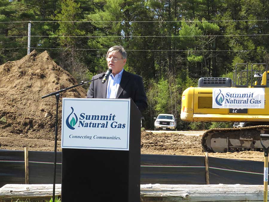 Mike Minkos, president of Summit Natural Gas of Maine, speaks at the company's official groundbreaking ceremony on May 2 at the Cumberland Fairgrounds.