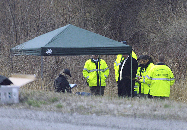 Massachusetts State Police stand along Interstate 190 near Sterling, Mass., on April 18 after a child's body was found.