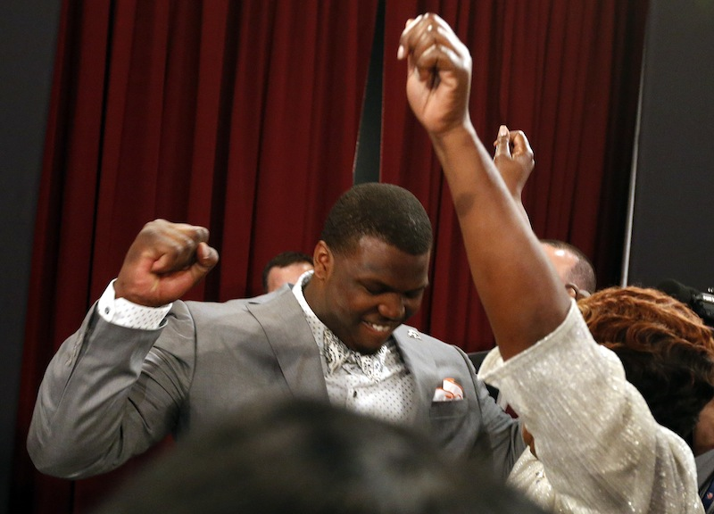 Greg Robinson, from Auburn, celebrates after being selected second overall in the first round of the NFL football draft by the St. Louis Rams, Thursday, May 8, 2014, at Radio City Music Hall in New York.