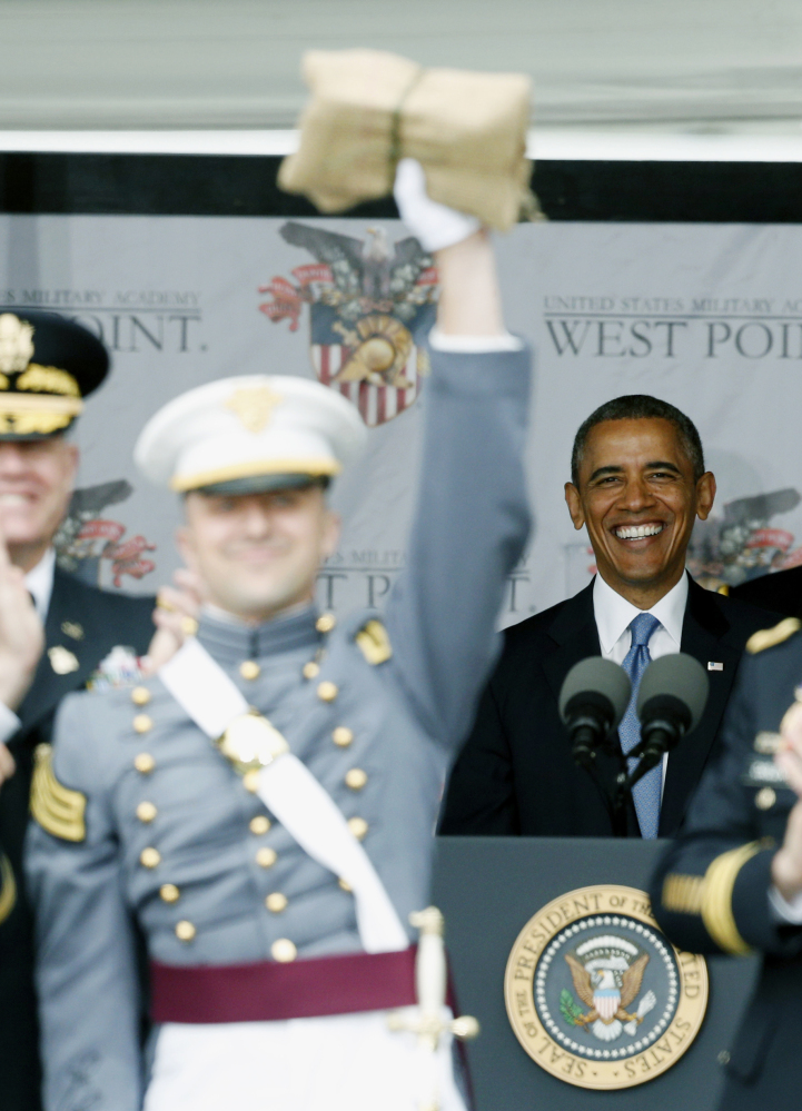 President Barack Obama smiles as Matthew Anthony Mayeaux of Long Beach, Miss., celebrates after graduating from the U.S. Military Academy during a ceremony Wednesday in West Point, N.Y. Mayeaux was the goat, which is the graduating cadet with the lowest grade-point average. The Associated Press