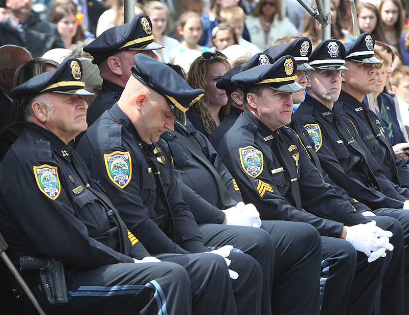 Brentwood, N.H., police officers listen during Monday's ceremony to honor Law Enforcement officers who died in the line of duty, held in Concord, N.H.