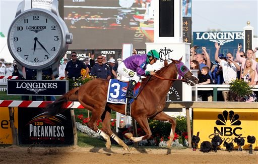 California Chrome, ridden by jockey Victor Espinoza, wins the 139th Preakness Stakes horse race at Pimlico Race Course on Saturday in Baltimore. Horse Race;Pimlico;Preakness
