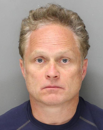 In this undated photo provided by the Philadelphia Police Department, Gary Dudek, 54, of Wallingford, Pa., is shown. Dudek, a former medical company sales representative was arrested in Monday, May 26, 2014 and charged charged with stealing more than $350,000 worth of human skin over a period of several years.