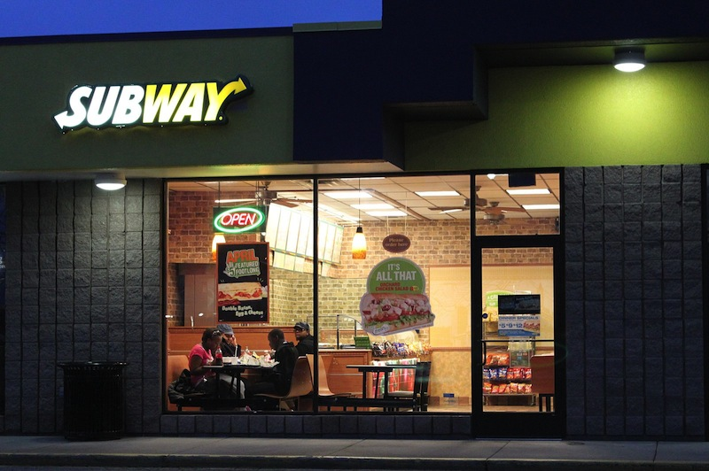 Subway is expanding both its menu and its stores by adding hummus to its offerings and franchises to its ever-growing empire, even as U.S. fast-food chains struggle to boost revenue.