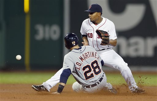 Tigers left fielder J.D. Martinez steals second base as Red Sox shortstop Xander Bogaerts gets the throw in the fourth inning in Boston on Sunday.