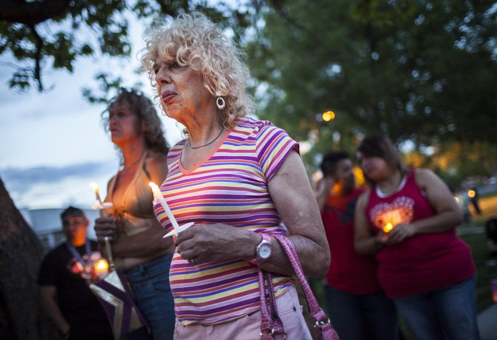 Denee Mallon attends a vigil Thursday in Albuquerque, N.M. A U.S. Department of Health and Services review board ruled Friday in favor of Mallon, 74, an Army veteran, whose request to have Medicare pay for her genital reconstruction was denied two years ago. The Associated Press