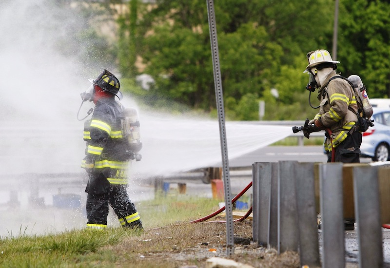 Bees swarm after being released from a tractor-trailer that overturned carrying them near Newark, N.J., Tuesday, May 20, 2014,. Bees