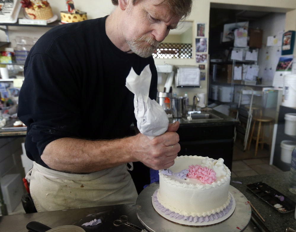 "Jack Phillips decorates a cake at his Masterpiece Cakeshop in Lakewood, Colo. ""I will stand by my convictions until somebody shuts me down,"" he said. The Associated Press"