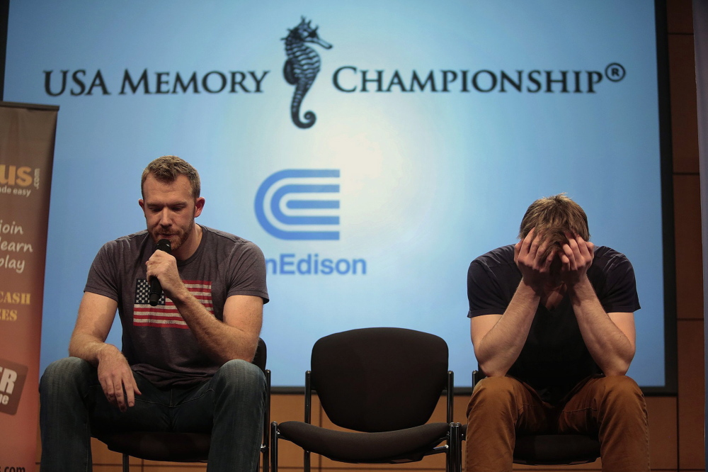 Nelson Dellis, left, of Miami, recalls cards while Alexander Mullen, of Oxford, Miss., concentrates during the 17th annual USA Memory Championship in New York on Thursday. Carolyn Cole/Los Angeles Times/MCT