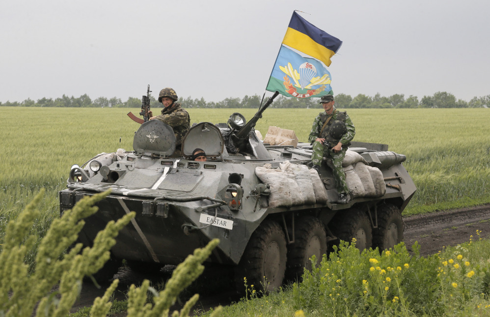 Ukrainian army paratroopers move to position in Slovyansk, Ukraine, on Saturday. The Ukrainian Acting Defense Minister said on Friday that troops had ousted separatists from southern and western parts of the Donetsk region and north of the Luhansk region. The Associated Press