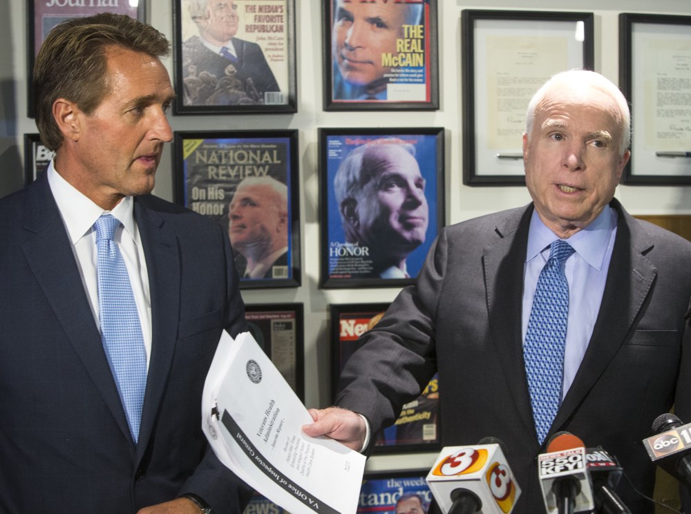 Arizona Republican Sens. John McCain, right, and Jeff Flake called for the VA chief to resign following a report on patients kept waiting at the Phoenix veterans hospital.