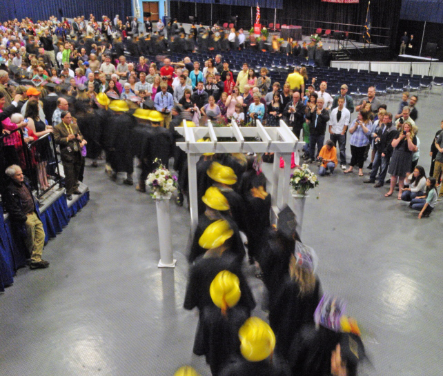 Graduates file into their Kennebec Valley Community College graduation on May 17 at the Augusta Civic Center.