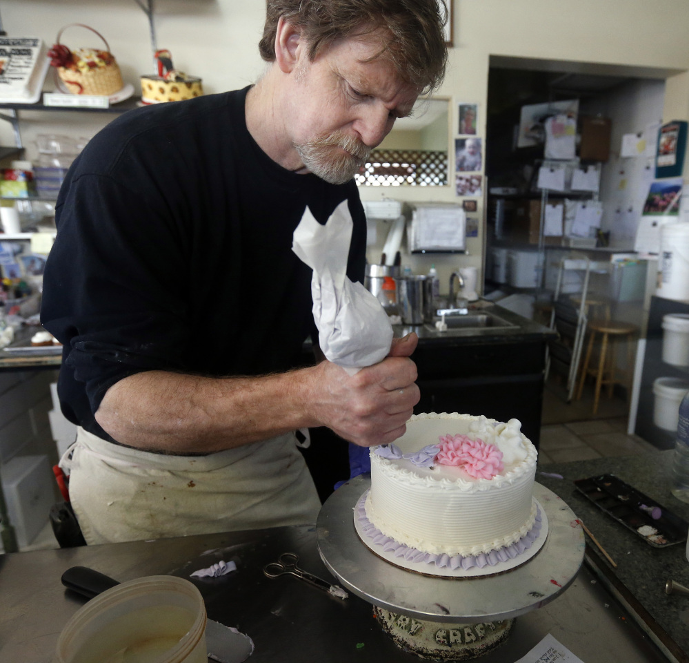 In this March 10, 2014 photo, Masterpiece Cakeshop owner Jack Phillips decorates a cake inside his store, in Lakewood, Colo. Phillips is appealing a recent ruling against him in a legal complaint filed with the Colorado Civil Rights Commission by a gay couple he refused to make a wedding cake for, based on his religious beliefs. The Associated Press/Brennan Linsley