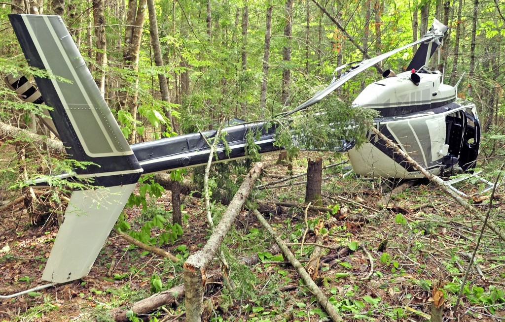 A helicopter sits in the wood after a crash landing on Friday in Whitefield.