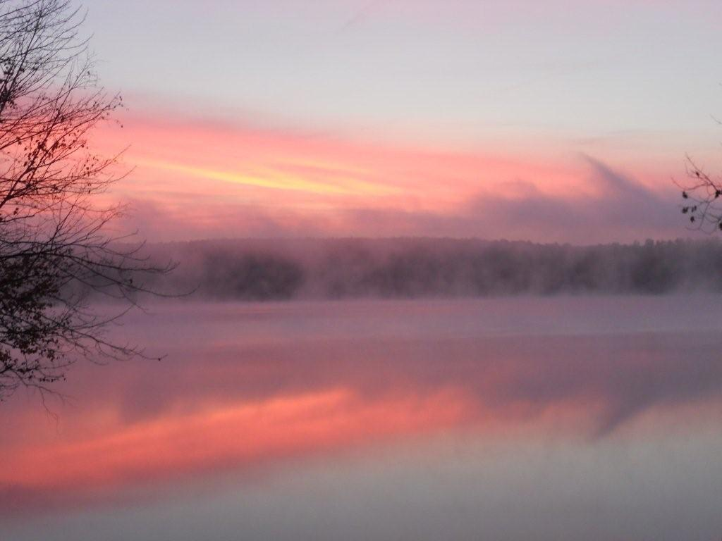 This is a October sunrise on little Sebago with a light fog off the lake. Glenn Lynds