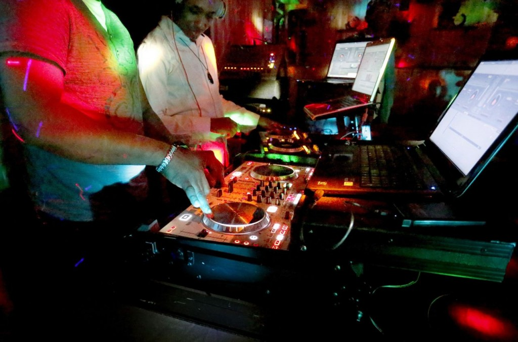 DJs perform at the Skybox Bar and Grill during a reggae show recently in Westbrook. Police have gotten a rising number of complaints about loud music at the bar.
