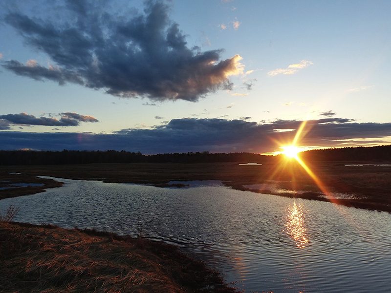 Spring sunset over Goosefair Brook. Photo by Laurie Blair Ernst of Saco