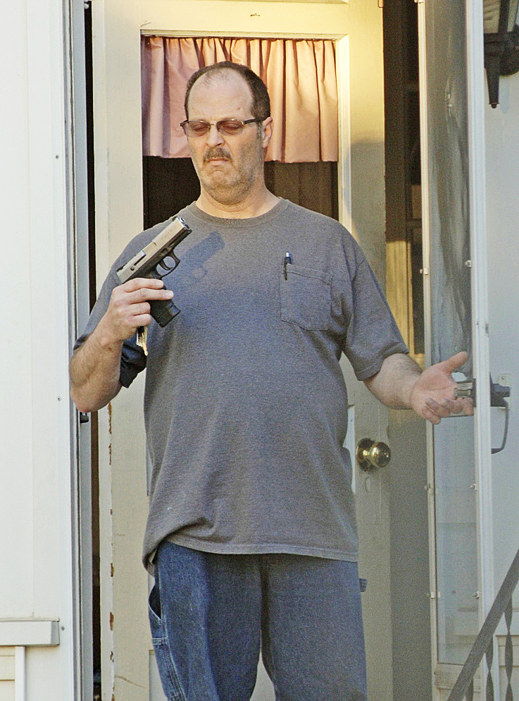 This photo taken by Barry Sturk, Susan Morissette's boyfriend, shows her ex-husband, Wilfred Morissette, holding a handgun on First Street in Winslow Sunday night. Wilfred Morissette was arrested and charged after he allegedly pointed the loaded gun at Susan Morissette, Sturk and a teen.