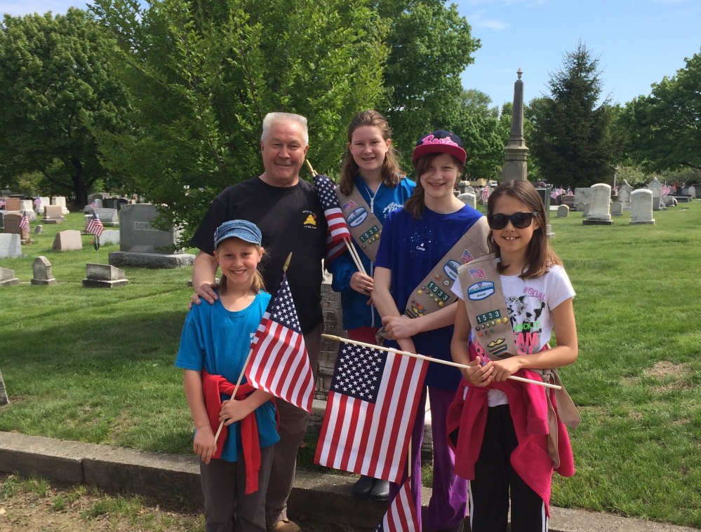 Clockwise from left, Abigail Freese, VFW Post 832 of South Portland Commander Sam Flint, Emily Freese, Laura LeFebvre and Mackenzie Farnham were among a group of 26 people who volunteered to place flags at the graves of 930 veterans at five South Portland cemeteries in observance of Memorial Day. Photo courtesy Amy Freese
