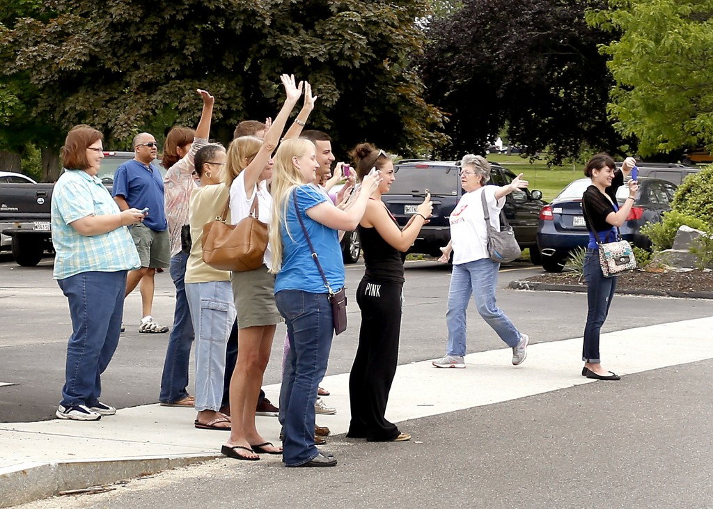 Fans cheer across the street from Uncle Andy's in South Portland on Tuesday. Uncle Andy's is being featured on Restaurant Impossible.